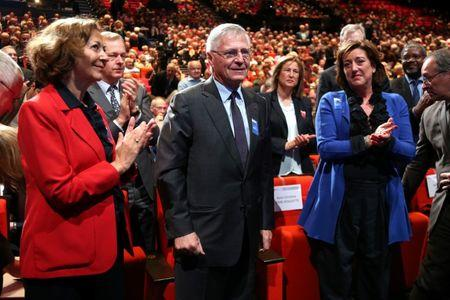 FILE PHOTO: French oil and gas company Total former CEO and Chairman of the Board Thierry Desmarest acknowledges applauds next to Board members Anne-Marie Idrac and Marie-Christine Coisne-Roquette in Paris