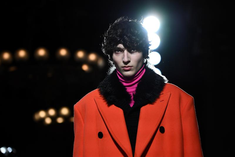 At Berluti, tumbling curls and thick brows underpinned the fashion show.