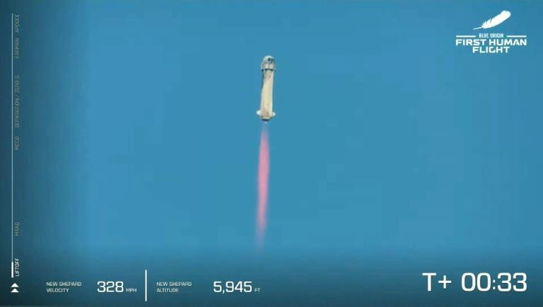 Blue Origin's reusable New Shepard craft launches into space from the desert in west Texas carrying Jeff Bezos and three other crew for the vessel's first human flight