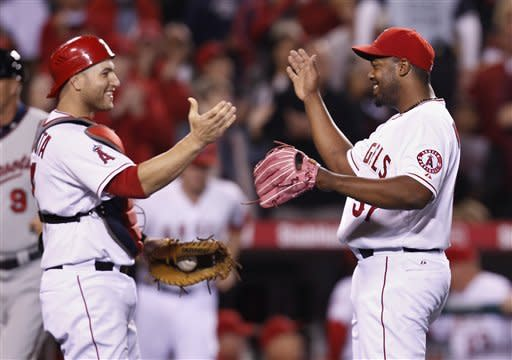 Los Angeles Angels pitcher Jerome Williams, right, celebrates with catcher Los Angeles Angels catcher Chris Iannetta after a three hit shutout in a baseball game against the Minnesota Twins in Anaheim, Calif., on Tuesday May 1, 2012. The Angels won 4-0. (AP Photo/Christine Cotter)