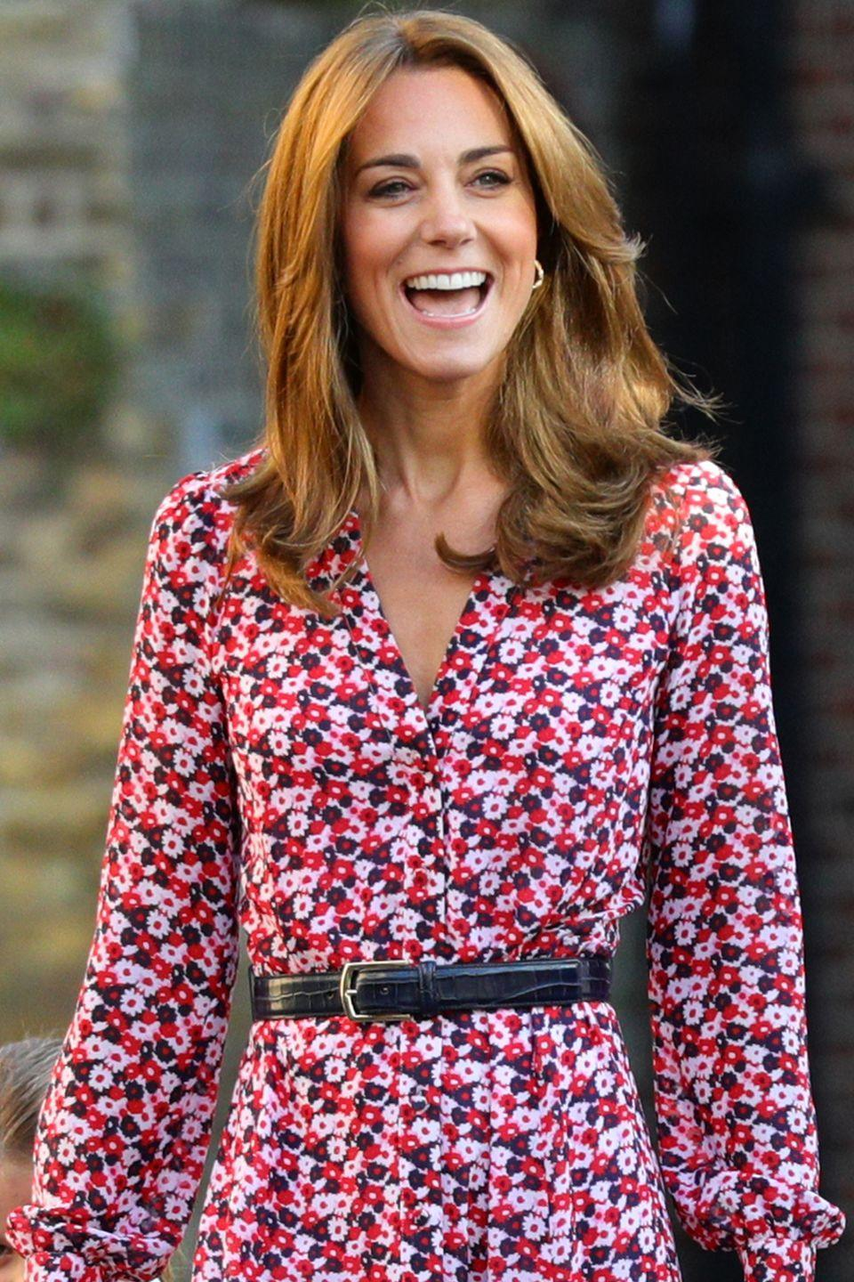 "<p>Kate Middleton stuns in a <a href=""https://www.harpersbazaar.com/celebrity/latest/a28917131/kate-middleton-prince-george-princess-charlotte-first-day/"" rel=""nofollow noopener"" target=""_blank"" data-ylk=""slk:floral dress"" class=""link rapid-noclick-resp"">floral dress</a> by Michael Kors for the big day.</p>"