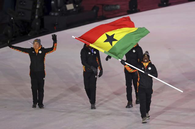 <p>Akwasi Frimpong carries the flag of Ghana during the opening ceremony of the 2018 Winter Olympics in Pyeongchang, South Korea, Friday, Feb. 9, 2018. (AP Photo/Michael Sohn) </p>