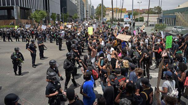 PHOTO: In this June 2, 2020, file photo, protestors gather in front of a row of LAPD officers during a demonstration over the death of George Floyd in Hollywood, Calif. (Agustin Paullier/AFP via Getty Images, FILE)