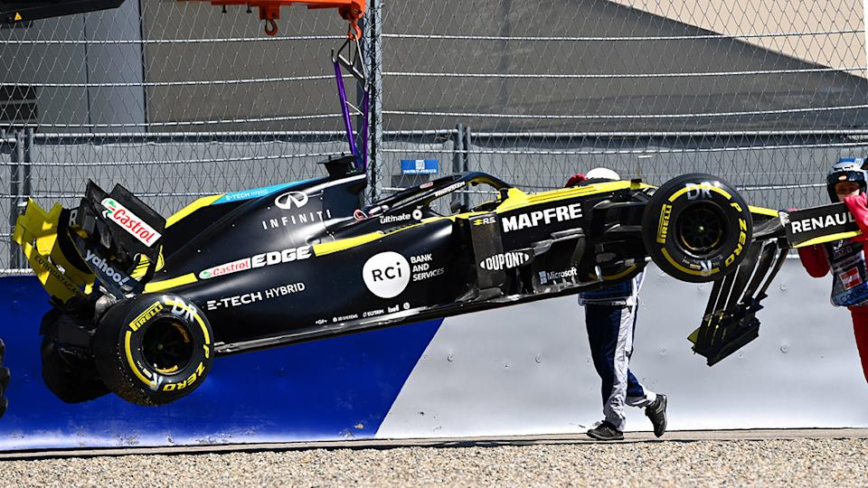 The car of Daniel Ricciardo, pictured here being removed from the circuit.