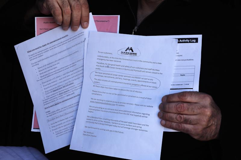 QUINCY, MA - MARCH 26: Anthony Tiro, a former journeyman pipe fitter with Local 537 Boston, show spaperwork he received when he went to the Mass Hire South Shore Career Center in Quincy, MA on March 26, 2020. Staff there would not listen to his questions. He has attempted and failed to log in to an account with the Department of Unemployment Assistant due to a password glitch. He was laid off from his job and has listened to a scheduled webinar by the DUA four times. (Photo by Pat Greenhouse/The Boston Globe via Getty Images)
