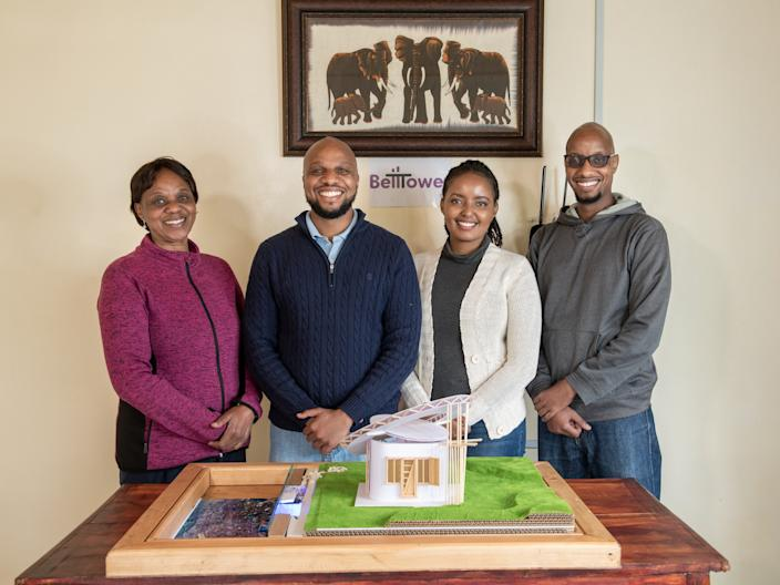 "<div class=""caption""> Kenya's BellTower design firm with a model of their winning Open Source Communities project. </div> <cite class=""credit"">Photo: Courtesy of Lexus</cite>"