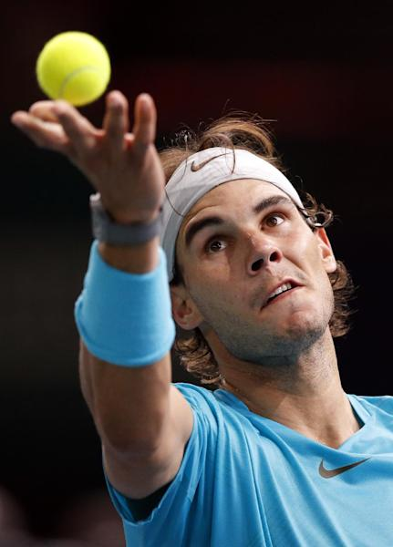 Rafael Nadal of Spain serves the ball to Jerzy Janowicz of Poland during their round of eight match, at the Paris Masters tennis at Bercy Arena in Paris, France, Thursday, Oct. 31, 2013. (AP Photo/Francois Mori)