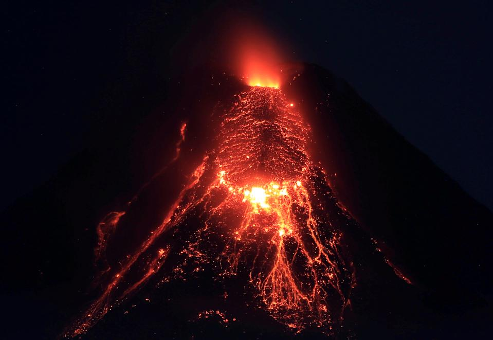 FILE PHOTO: Lava flows from the crater of Mount Mayon Volcano during an eruption in Legazpi city, Albay on January 28, 2018. (Source: REUTERS/Romeo Ranoco)