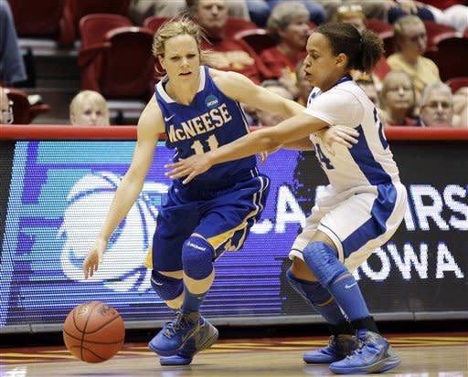 McNeese State guard Caitlyn Baggett, left, drives around Kentucky guard Amber Smith during the first half of an NCAA tournament first-round women's college basketball game, Saturday, March 17, 2012, in Ames, Iowa. (AP Photo/Charlie Neibergall)