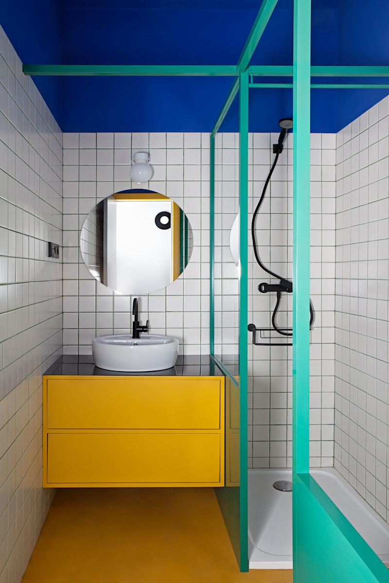 After: The third bathroom is the most vibrant of all, inspired by the vivid hues found at the Majorelle Garden in Marrakech. Even the grout is eye-catching; the duo developed its teal color with the installer.