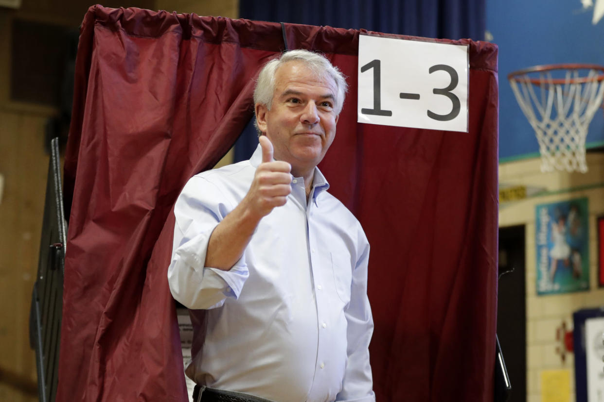 Hugin gestures after casting his vote in the New Jersey primary election on June 5, 2018, in Summit, N.J. (Photo: Julio Cortez/AP)