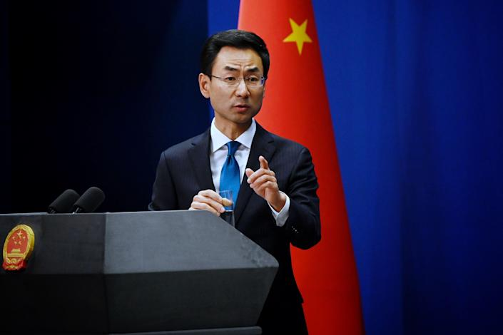 China's foreign affairs spokesman Geng Shuang answers a question during a briefing in Beijing on November 28, 2019.