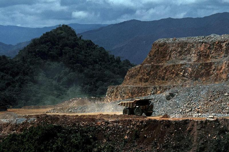 In this photo taken March 20, 2012, a truck drives along a hill of Pueblo Viejo mine in the Sanchez Ramirez province, about 60 miles (100 kms) northwest of Santo Domingo, Dominican Republic. One of the world's largest gold mining operations, run by a joint venture of Canadian companies Barrick Gold and Goldcorp, is about to open in the Dominican Republic, where the industry has a toxic legacy of pollution that stained rivers a searing red and failed to lift the fortunes of this largely poor country. (AP Photo/Manuel Diaz) DOMINICAN REPUBLIC OUT - NO USAS EN REPUBLICA DOMINICANA