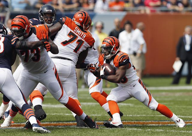Cincinnati Bengals running back Giovani Bernard (25) looks for running room against Chicago Bears defenders during the first half of an NFL football game, Sunday, Sept. 8, 2013, in Chicago. (AP Photo/Charles Rex Arbogast)