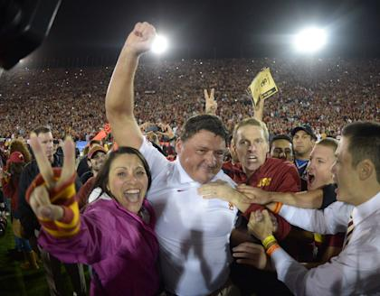 Former USC coach Ed Orgeron celebrates with fans after a win last season. (USA TODAY Sports)