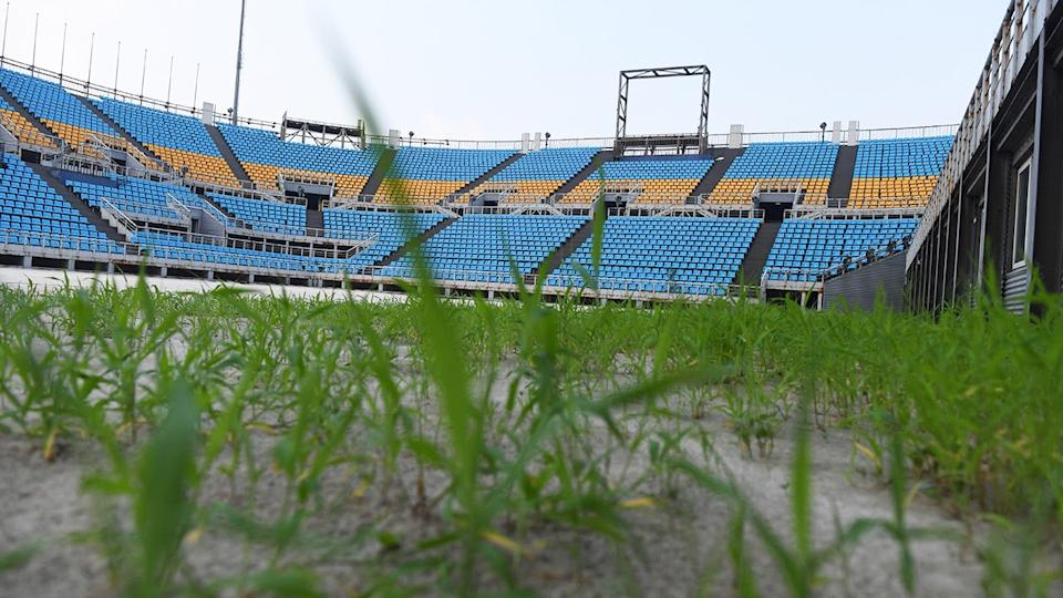 Grass is seen growing in the beach volleyball stadium built for the 2008 Beijing Olympic Games. (Greg Baker/AFP via Getty Images)