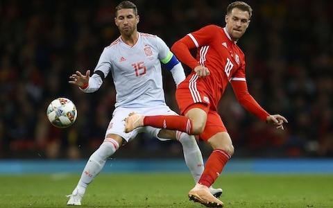 Aaron Ramsey playing for Wales in their 4-1 thrashing by Spain - Credit: afp
