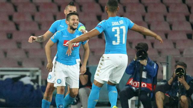 Napoli remain top of Group B after inflicting a first defeat of the season upon Benfica, with Dries Mertens scoring twice in a 4-2 win