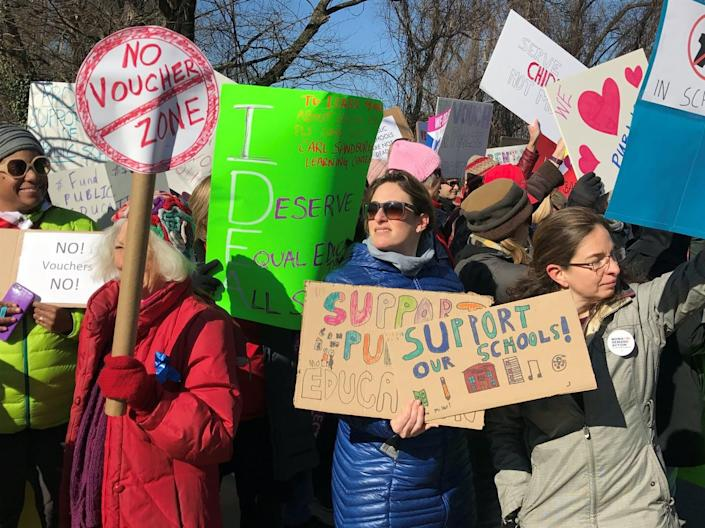 """<span class=""""caption"""">Protesters gather as Education Secretary Betsy DeVos visits a school in Maryland.</span> <span class=""""attribution""""><a class=""""link rapid-noclick-resp"""" href=""""https://www.gettyimages.com/detail/news-photo/large-group-of-protesters-gather-after-devos-enters-the-news-photo/657150080?adppopup=true"""" rel=""""nofollow noopener"""" target=""""_blank"""" data-ylk=""""slk:Sarah L. Voisin/The Washington Post via Getty Images"""">Sarah L. Voisin/The Washington Post via Getty Images</a></span>"""