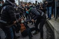 """Turkish police detain a woman during a demonstration outside Bogazici University in Istanbul on February 1, 2021 after President Recep Tayyip Erdogan accused LGTQI rights activists of """"vandalism"""""""