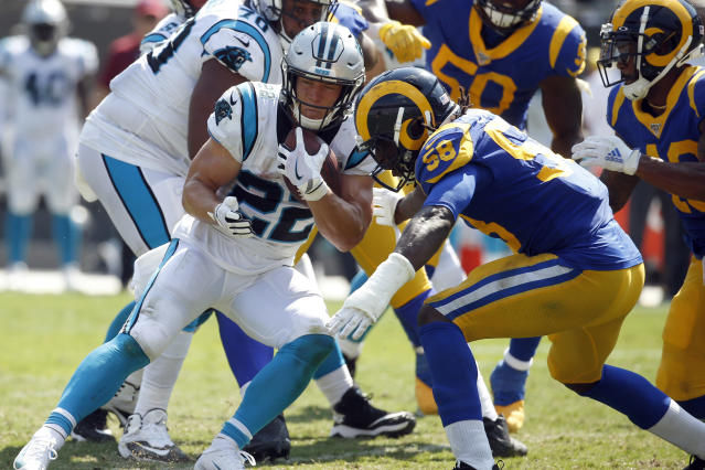 Carolina Panthers running back Christian McCaffrey (22) runs while Los Angeles Rams inside linebacker Cory Littleton (58) tackles during the second half of an NFL football game in Charlotte, N.C., Sunday, Sept. 8, 2019. (AP Photo/Brian Blanco)