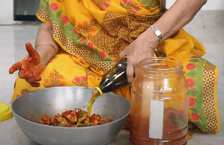 """<div class=""""paragraphs""""><p>The oil adds extra flavour to the pickle.</p></div>"""