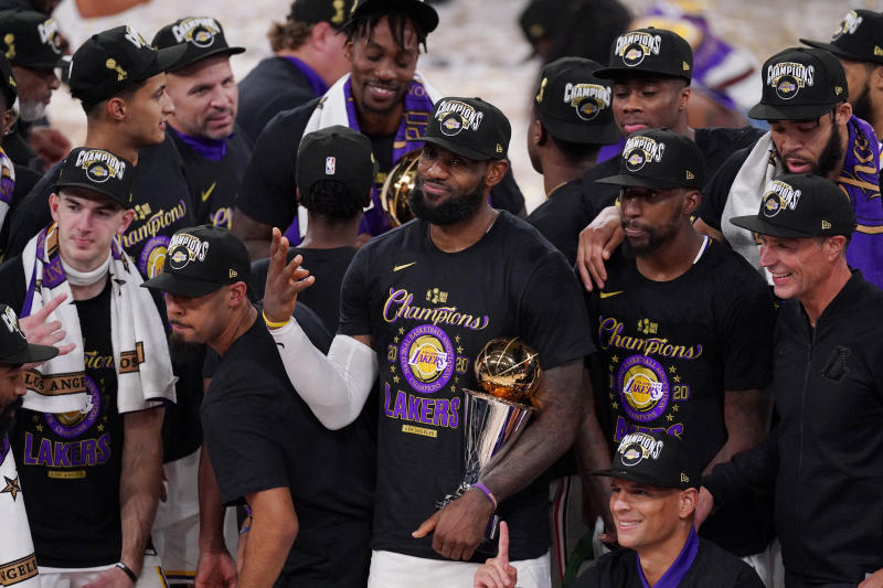 LeBron James celebrates with his teammates after the Lakers defeated the Miami Heat 106-93 in Game 6 of the NBA Finals on Sunday night. (AP Photo/Mark J. Terrill)