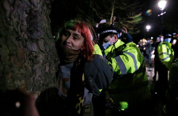 PHOTO: A woman is arrested during a vigil for Sarah Everard on Clapham Common on March 13, 2021 in London, United Kingdom. Vigils are being held across the United Kingdom in memory of Everard. (Hollie Adams/Getty Images)