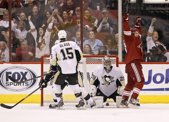 Phoenix Coyotes' Antoine Vermette, right, celebrates a goal by teammate Mike Ribeiro as Pittsburgh Penguins goaltender Marc-Andre Fleury (29) and Tanner Glass (15) look on during the first period of an NHL hockey game on Saturday, Feb. 1, 2014, in Glendale, Ariz. (AP Photo/Ralph Freso)