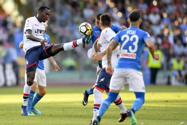 Crotone's Simy, left, reaches for the ball during the Serie A soccer match between Crotone and Napoli, at the San Paolo stadium in Naples, Italy, Sunday, May 20, 2018. (Ciro Fusco/ANSA via AP)