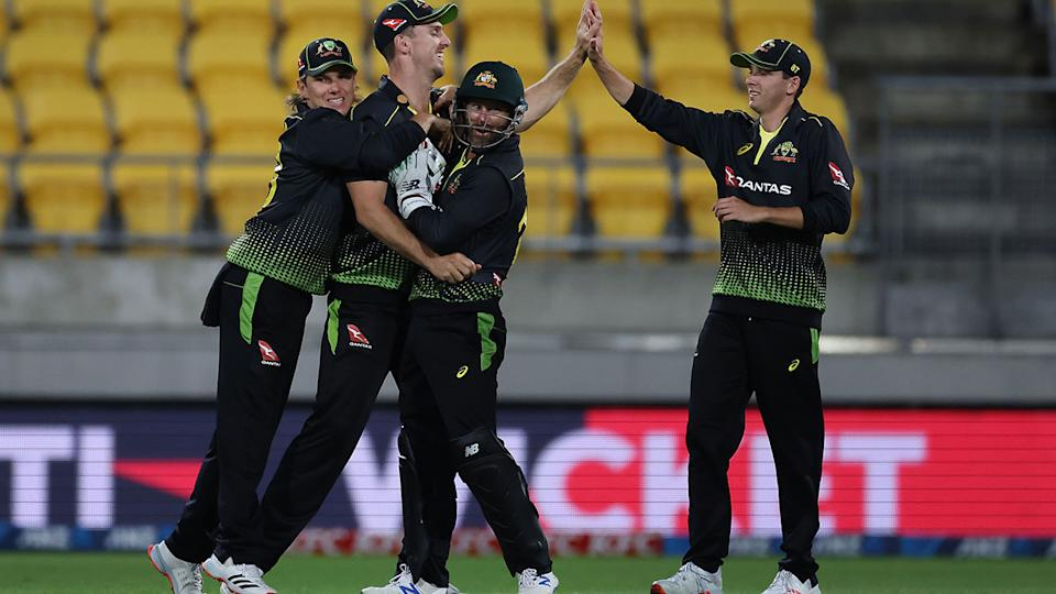Australia's players celebrate the wicket of New Zealand's captain Kane Williamson during the fourth T20 match. (Photo by Marty MELVILLE / AFP) (Photo by MARTY MELVILLE/AFP via Getty Images)