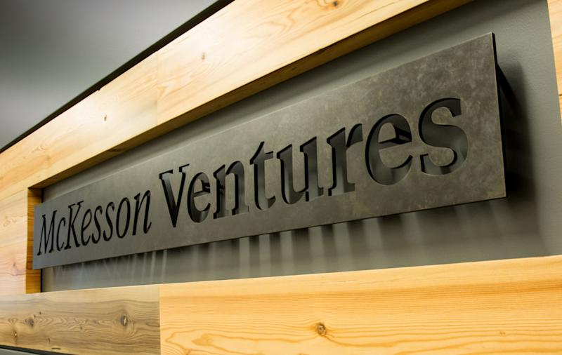 "Metal sign reading ""McKesson Ventures"" in a wood frame"