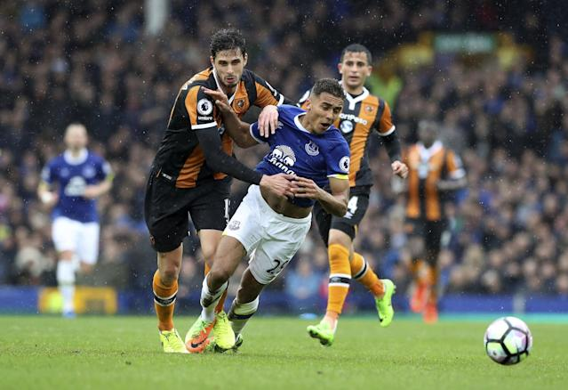 <p>Everton's Dominic Calvert-Lewin, right, and Hull City's Andrea Ranocchia battle for the ball </p>