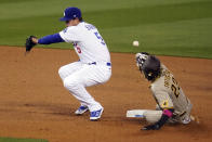San Diego Padres' Fernando Tatis Jr., right, steals second base as Los Angeles Dodgers shortstop Corey Seager (5) misses the throw from home plate during the fourth inning of a baseball game Thursday, April 22, 2021, in Los Angeles. (AP Photo/Marcio Jose Sanchez)