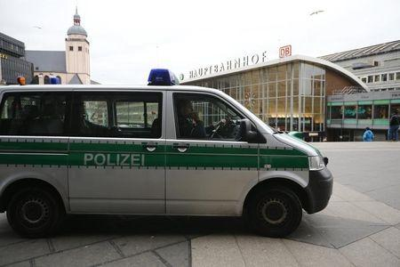 A police vehicle patrols at the main square and in front of the central railway station in Cologne, Germany, January 5, 2016. REUTERS/Wolfgang Rattay