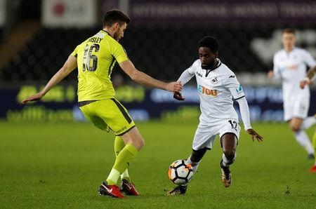 Soccer Football - FA Cup Fourth Round Replay - Swansea City vs Notts County - Liberty Stadium, Swansea, Britain - February 6, 2018 Swansea City's Nathan Dyer in action with Notts County's Shaun Brisley Action Images via Reuters/Matthew Childs