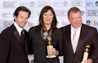 KRT ENTERTAINMENT STORY SLUGGED: GOLDENGLOBES KRT PHOTOGRAPH BY HAHN-KHAYAT/ABACA PRESS (January 17) LOS ANGELES, CA -- Best supporting actor and actress in a TV series winners Anjelica Huston and William Shatner, right, with presenter Mark Wahlberg, left, in the pressroom at the 62nd Annual Golden Globe Awards in Los Angeles, California, on January 16, 2005. (Photo by cdm) 2005