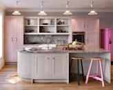 """<b>Unexpected pop of colour</b><br><br>Who said you need bright colours to make a striking design statement? A surprise pop of pastel can be a sophisticated way to add interest. This <a href=""""http://www.john-lewis.co.uk/kitchen-ranges/shaker.php"""" rel=""""nofollow noopener"""" target=""""_blank"""" data-ylk=""""slk:Shaker kitchen"""" class=""""link rapid-noclick-resp""""><span>Shaker kitchen</span></a> from John Lewis of Hungerford features three shades of pink for a calm and elegant look. The grey marble worktops and splashback compliment the soft grey of the island unit and open shelving – which keep the room looking airy rather than confined."""