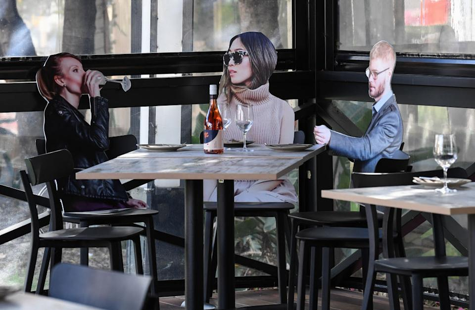 'Cardboard customers' sitting at tables inside Five Dock Dining restaurant. Getty Images