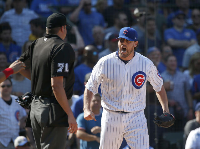 John Lackey screaming at umpire Jordan Baker during Friday's game. (AP)