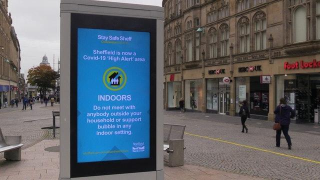 A coronavirus advice sign in Sheffield city centre