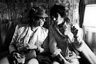 <p>Keith Richards and Ron Wood of the Rolling Stones chat on their plane while on tour in 1975. </p>