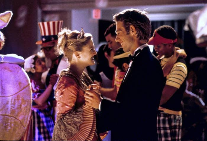 Drew and Michael's characters share a dance at a costume party