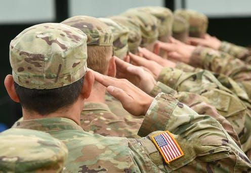 """<span class=""""attribution""""><a class=""""link rapid-noclick-resp"""" href=""""https://www.shutterstock.com/image-photo/us-soldiers-giving-salute-716351914?src=9U2Ns5Na0uerisvkm8YKKQ-1-2"""" rel=""""nofollow noopener"""" target=""""_blank"""" data-ylk=""""slk:Shutterstock"""">Shutterstock</a></span>"""
