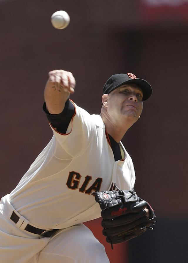 San Francisco Giants pitcher Tim Hudson throws against the Washington Nationals during the fourth inning of a baseball game in San Francisco, Thursday, June 12, 2014. The Giants won 7-1. (AP Photo/Jeff Chiu)