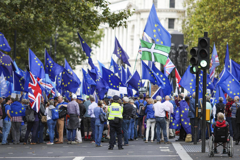 Anti Brexit demonstrators attend a protest at Parliament Square in London, Tuesday, Sept. 3, 2019. Lawmakers returned from their summer recess Tuesday for a pivotal day in British politics as they challenged Prime Minister Boris Johnson's insistence that the U.K. leave the European Union on Oct. 31, even without a withdrawal agreement to cushion the economic blow. (AP Photo/Vudi Xhymshiti)