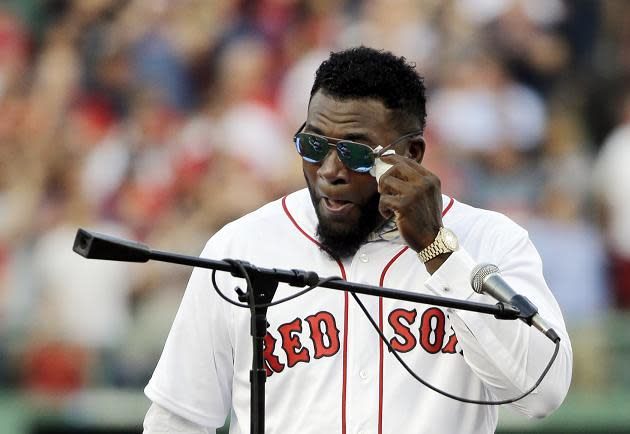 David Ortiz wipes away tears during his jersey retirement ceremony Friday night at Fenway Park. (AP)