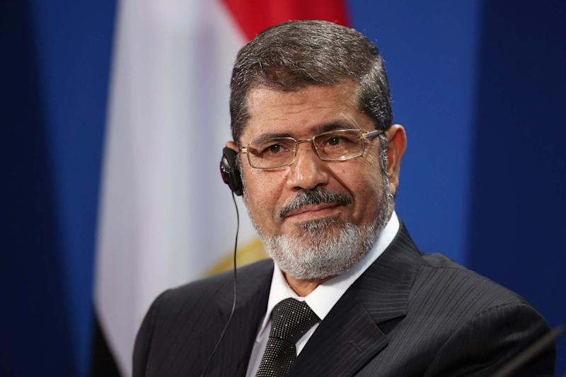 File photo: Egyptian President Mohamed Mursi speaks to the media with German Chancellor Angela Merkel in 2013 (Getty Images)