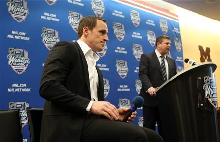 Dec 31, 2013; Ann Arbor, MI, USA; Toronto Maple Leafs defenseman Dion Phaneuf (left) listens to general manager Dave Nonis at a press conference during practice the day before the Winter Classic hockey game against the Detroit Red Wings at Michigan Stadium. Jerry Lai-USA TODAY Sports