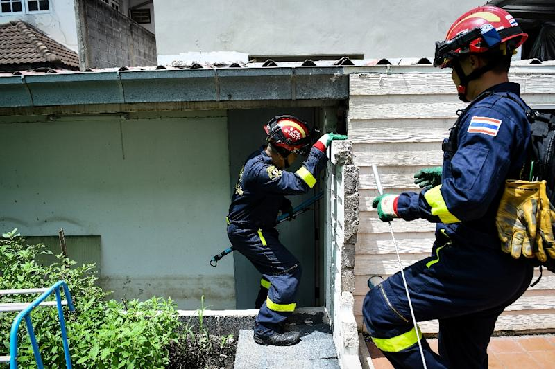 Thai firefighters are often called out to deal with snakes in homes if they have rates, or during the rainy season when hatchlings are born (AFP Photo/Lillian SUWANRUMPHA)